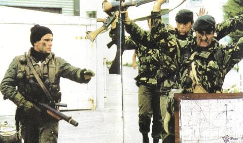Santa Fe landed these Argentine commandos (Seen left with Sterling submachine gun) in this infamous photo of Royal Marines surrendering