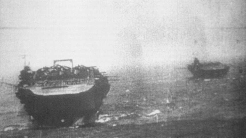 Kaga steams through heavy north Pacific seas, enroute to attack Pearl Harbor, Hawaii, circa early December 1941. Carrier Zuikaku is at right. Frame from a motion picture film taken from the carrier Akagi. The original film was found on Kiska Island after U.S. recapture in 1943. U.S. Naval History and Heritage Command Photograph.