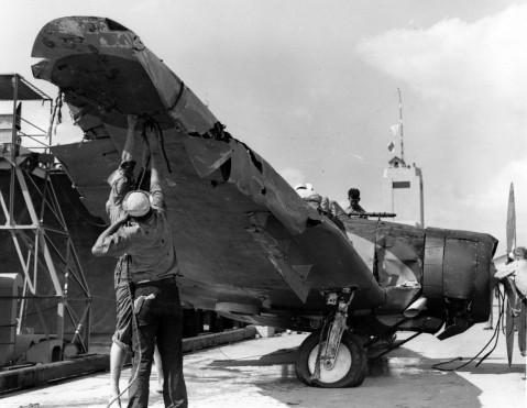 kaga air wing Japanese Navy Type 99 Carrier Bomber (Val) is examined by U.S. Navy personnel following its recovery from Pearl Harbor