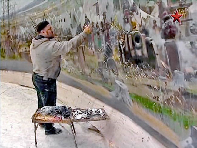 Ryzhenko at work on a mural. He completed several huge ones including the painting at the Minsk military park.