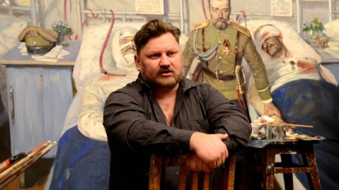 "Ryzhenko in his studio in 2013 with ""Wounded"" behind him"