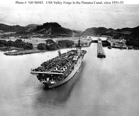 USS Valley Forge (CVA-45) Approaches the Pedro Miguel Lock while transiting the Panama Canal, circa 18 August 1953. Her deckload includes several TBM, F4U and F2H aircraft and many automobiles Photo #: NH 96943