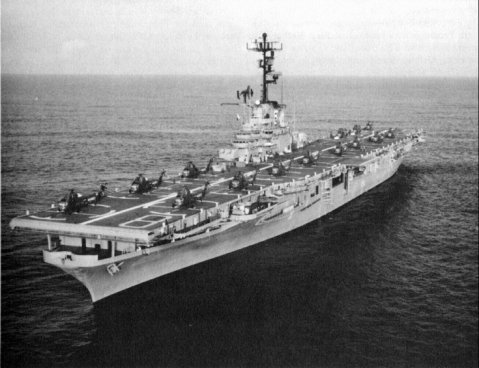 """Underway in the Pacific Ocean, circa 1962-63, prior to her """"FRAM II"""" overhaul. She has fifteen UH-34 helicopters spotted in take-off positions on her flight deck. Photo #: NH 96946"""