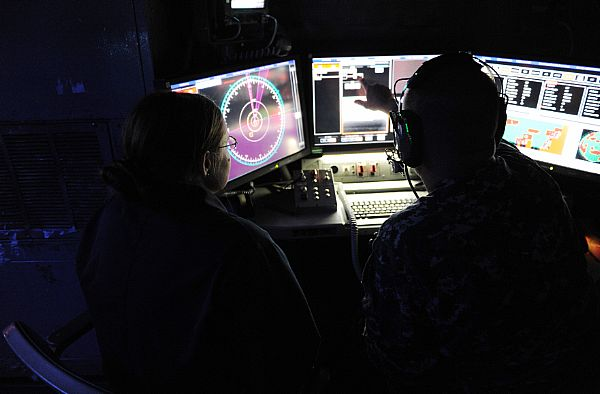 141116-N-PO203-134  ARABIAN GULF (Nov. 16, 2014) Chief Fire Controlman Brett Richmond, right, and Lt. j.g. Katie Woodard, operate the Office of Naval Research (ONR)-sponsored Laser Weapon System (LaWS) installed aboard the Afloat Forward Staging Base (Interim) USS Ponce (ASB(I) 15) during an operational demonstration in the Arabian Gulf. Directed energy weapons can counter asymmetric threats, including unmanned and light aircraft and small attack boats. (U.S. Navy photo by John F. Williams/Released)