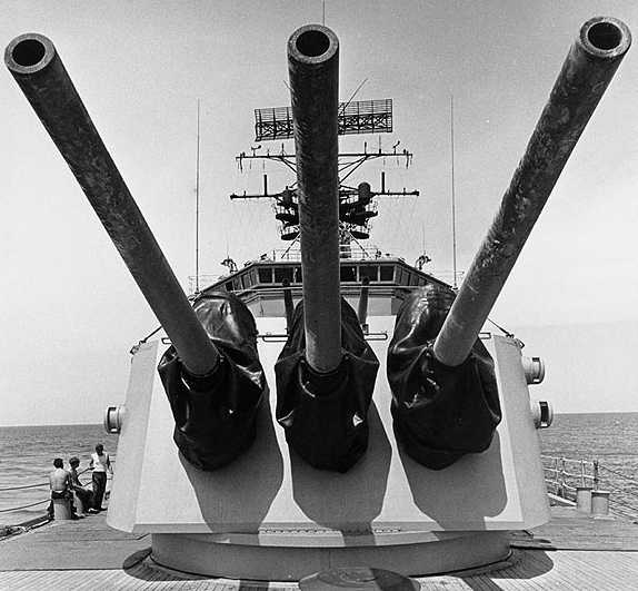 """USS Oklahoma City (CLG 5) View of the ship's 6""""/47 guns. Photograph was received in August 1972 and was probably taken during naval gunfire support operations off Vietnam earlier in that year as the paint on the gun barrels is charred and blistered from the heat of firing. Official U.S. Navy Photograph, from the collections of the Naval Historical Center #NH 98680."""