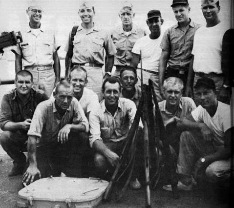 Crew on board Point White with weapons confiscated from a Vietnamese junk sunk in a battle with this 82 footer