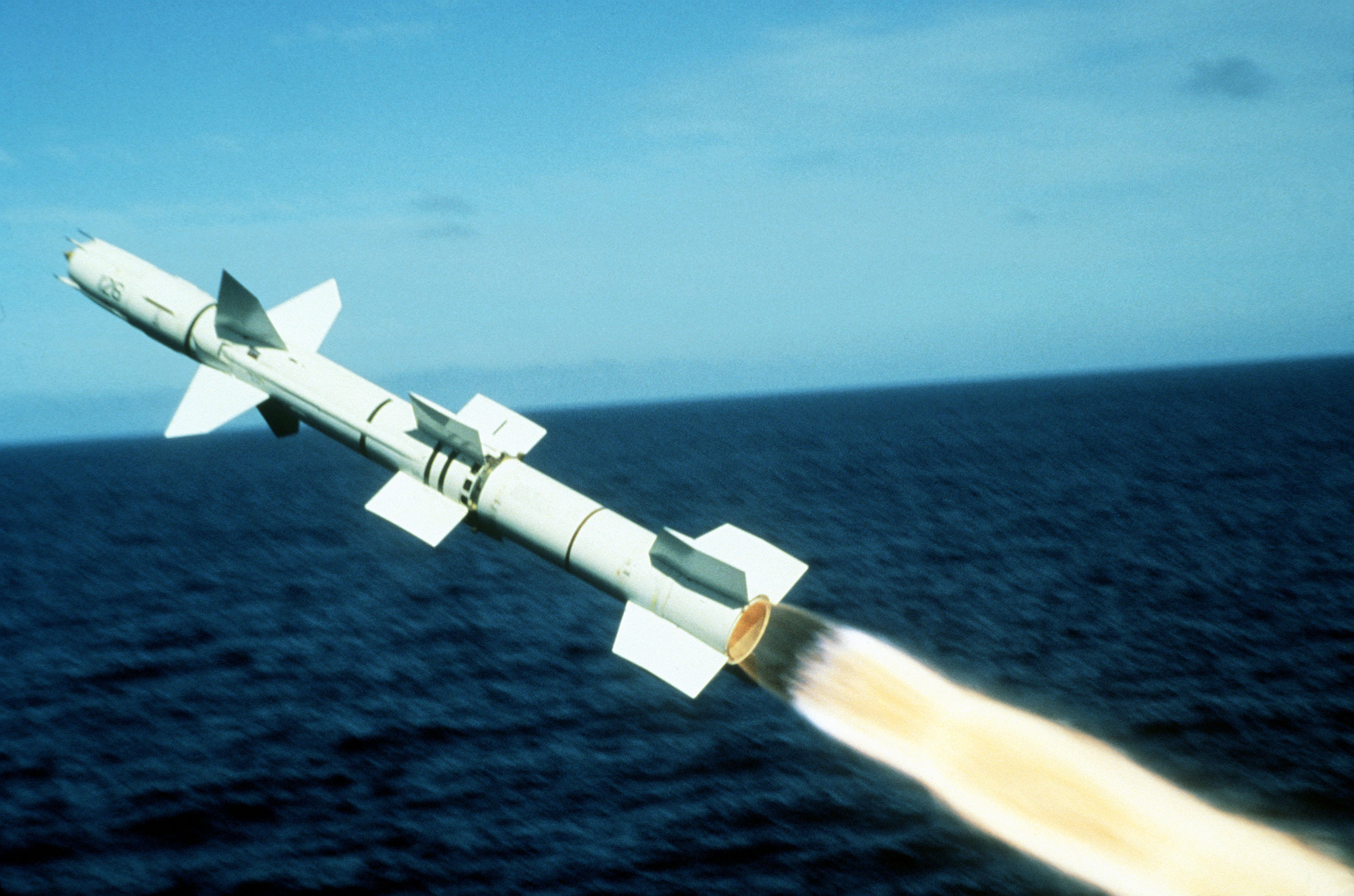 A view of a Talos surface-to-air guided missile, moments after being launched from the starboard side of the guided missile cruiser USS OKLAHOMA CITY (CG 5) at the Pacific Missile Test Range. This is the final firing of the Talos missile by the United States Navy conducted on 1 Nov 1979 National Archive# NN33300514 2005-06-30 by PH1 DAVID C. MACLEAN.