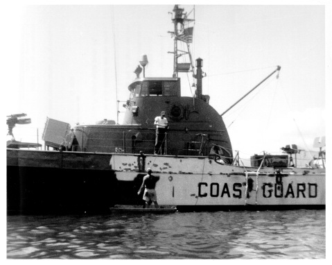 USCG Cutters nesting in Subic Bay before heading to Vietnam being painted gray