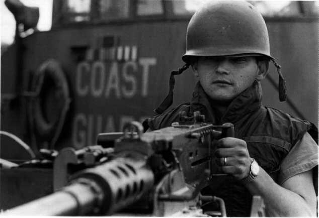 USCG gunner at the ready of his 50-cal aboard an unamed Point of CGS1 in Vietnam,1970 USN photo