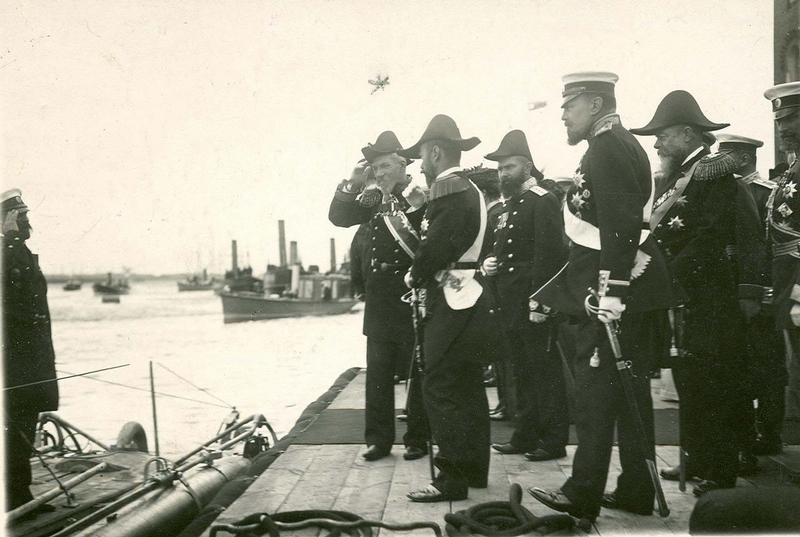 Emperor Nicholas II is listening to the report of the Russian captain at the Baltic shipbuilding and mechanical factory