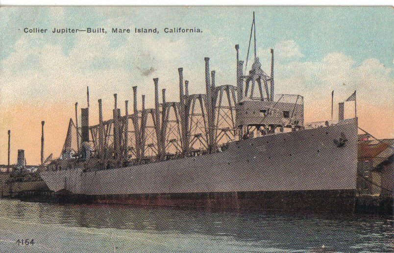 Post card of USS Jupiter moored pier side, probably at Mare Island Navy Yard, sometime about the time of her completion in 1913. Robert M. Cieri via Navsource