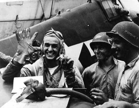 "Lt. Alex Vraciu uses his hands to indicate his downing of six aircraft in a single day, June 19, 1944. All were Yokosuka D4Y ""Judies"" shot down in a period of just 8 minutes."