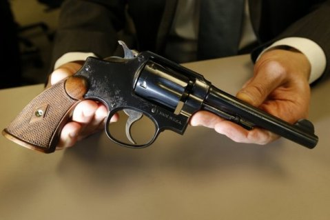 Internal Revenue Service Special Agent In Charge Jonathan Larsen, holds a Smith & Wesson .38 Special during an interview in Mountainside, N.J. (AP Photo/Julio Cortez)
