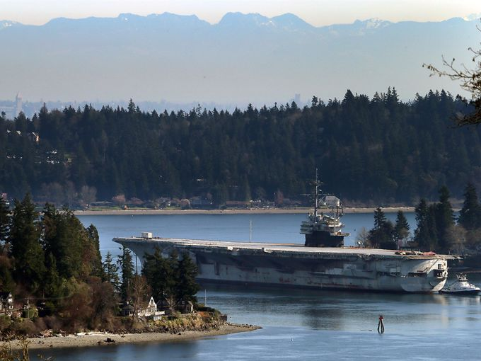The USS Ranger is towed through Rich Passage for the last time on March 5 in Bremerton, Wash., as the historic aircraft carrier heads to Texas to be dismantled.
