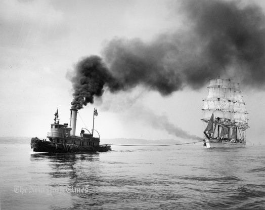 The full-rigged ship Tusitala returning to New York with cargo from across the South Atlantic has run out of wind. The steam tug Federal No. 1 is towing, while a second tug lies along the starboard side of the ship in order to assist in the docking. Via NYT