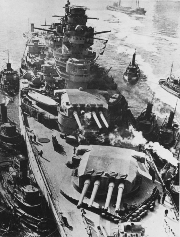 Battleship Richelieu arriving in New York for refit. The fire control director on the fore tower had to be dismantled for her to pass under the Brooklyn Bridge. Note damaged turret