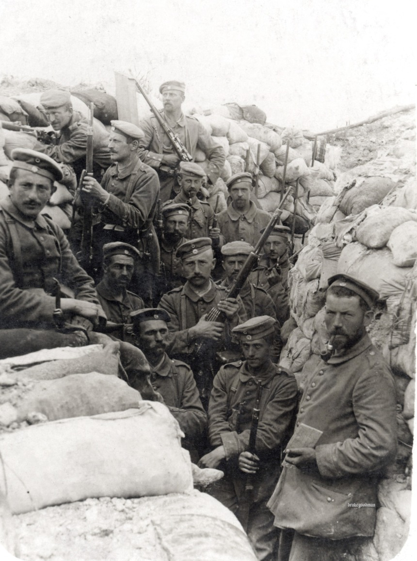 Bavarian troops pose in a trench, 1915. Note the man at the rear - his Gew98 is outfitted with a scope, and he wears both the lanyard of a Schutzenschnur that identifies him as a marksman, and the steely look of a man not to be trifled with. Click to big up
