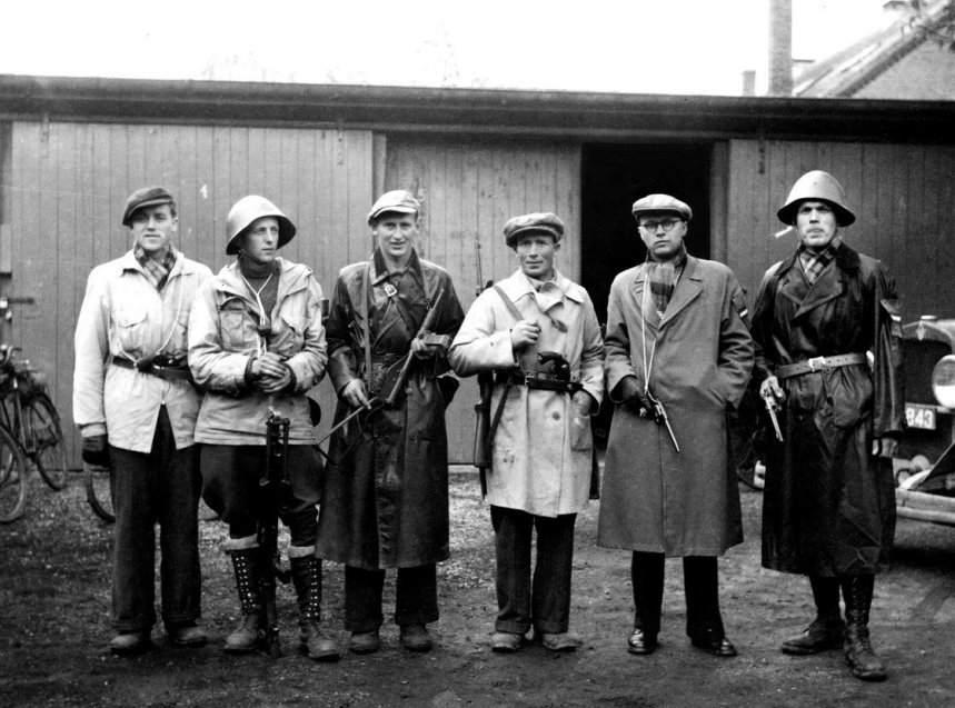 Danish resistance fighters note the mix of arms to include a BREN, a number of  Danish Army Nagant revolvers, and a couple of very Darth Vaderish  Royal Danish army helmets