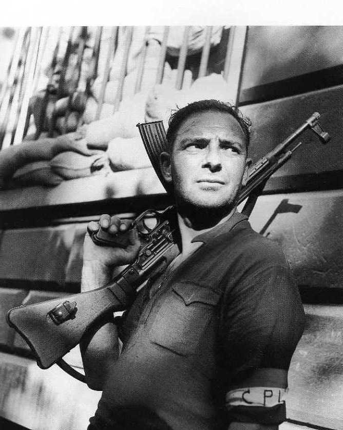 French fighter of the resistance holding his STG 44. I wouldn't trade a STEN for anything but...