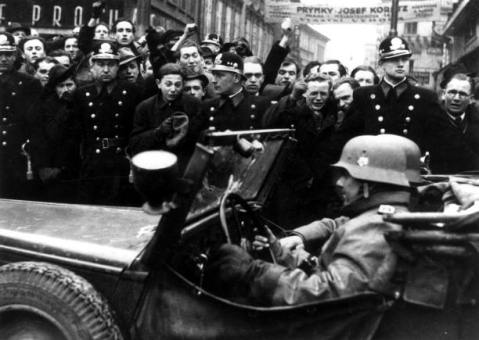 Non a smile in the bunch on either side. German troops enter Prague,March 1939. Mucha would be dead within four months and his very funeral a spark of resistance in occupied Europe-- one of the first.
