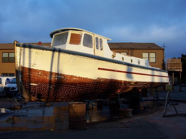 An old 38 up for sale in 2012. Not too bad a shape for a 70+ year old wooden boat built by the lowest bidder.