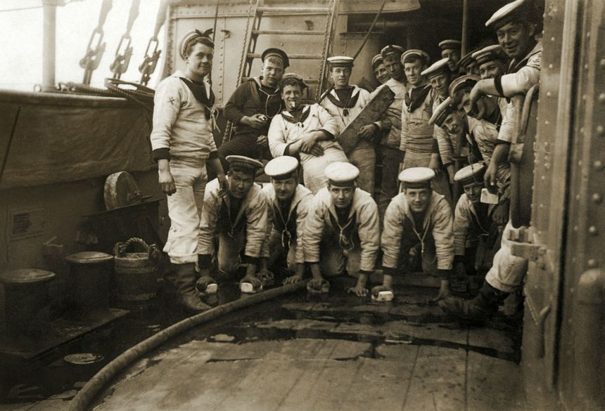 Sailors holystoning the deck of Pelorus-class protected cruiser HMS Pandora in the early 20th century