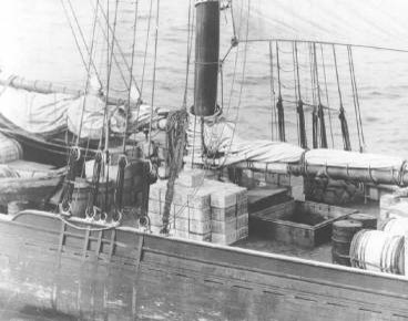 A schooner loaded high with whiskey on rum row.USCG Photo