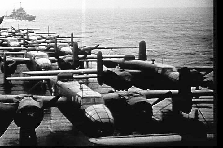 USS Nashville (CL 43) (in the distance), as seen from the island of USS Hornet (CV 8) (looking aft)