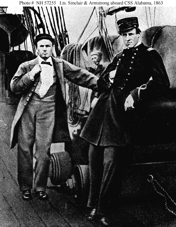 """Two of the CSS Alabama's officers on deck, during her visit to Capetown in August 1863. They are Lieutenant Arthur Sinclair IV, (left) and Lieutenant Richard F. Armstrong (USNA 1861). The gun beside them is a 32-pounder of Lt. Sinclair's Division. Halftone image, copied from Sinclair's book, """"Two Years on the Alabama"""". US Naval History and Heritage Command photo # NH 57255. via Navsource"""