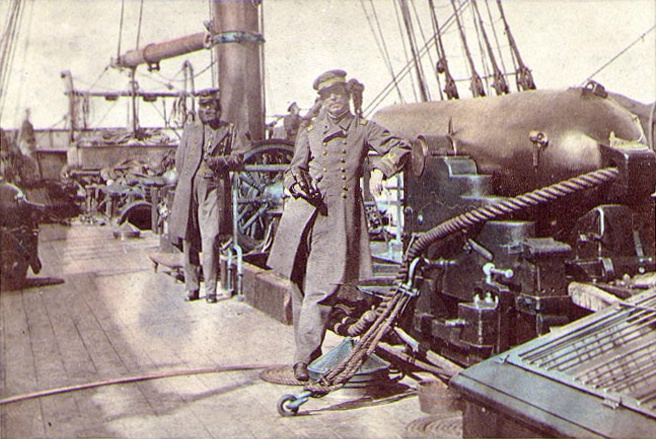 Captain Raphael Semmes CSN, CSS Alabama's commanding officer, standing by his ship's 110-pounder rifled gun during her visit to Capetown in August 1863. His executive officer, First Lieutenant John M. Kell CSN, is in the background, standing by the ship's wheel.US Naval History and Heritage Command photo # NH 57256 from the collection of Rear Admiral Ammen C. Farenholt, USN(MC), 1931.