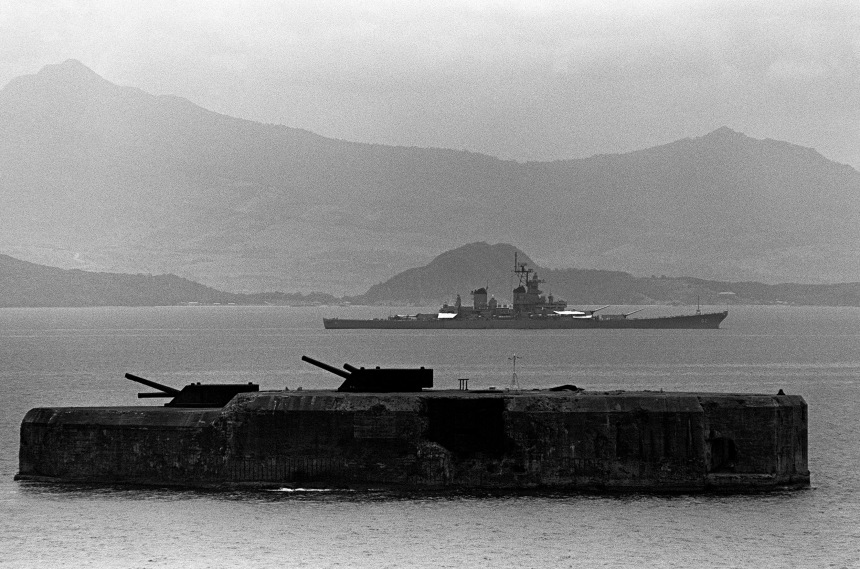 Starboard beam view of the battleship USS NEW JERSEY (BB-62) passing between CORREGIDOR (background) and FORT DRUM as she enters Manila Bay. Date: 3 Jul 1983 Camera Operator: PH2 PAUL SOUTAR ID: DN-SN-83-09891 Click to big up
