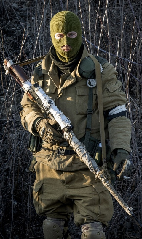 Russian-backed separatists wait for their transport, preparing to leave towards the frontline, in the village of Vergulivka, just outside Debaltseve, eastern Ukraine, on Friday, Feb. 13, 2015. Fierce fighting surged Friday in eastern Ukraine as Russian-backed separatists mounted a major, sustained offensive to capture a strategic railway hub ahead of a weekend cease-fire deadline. At least 25 people were killed across the region, officials reported. (AP Photo/Maximilian Clarke)