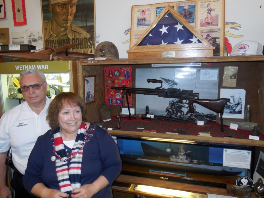 LaSalle County Sheriff Tom Templeton and Jane Sullivan-DePaoli pose with the Japanese Type 99 light machine gun recovered by her father from a pillbox on Iwo Jima. (Photo: Livingston County War Museum)