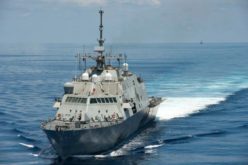 The littoral combat ship USS Fort Worth (LCS 3) conducts routine patrols on Monday in international waters near the Spratly Islands as the Chinese People's Liberation Army-Navy (PLAN) guided-missile frigate Yancheng (FFG 546) sails close behind (the dot on the horizon)-- click to big up. U.S. Navy/MC2 Conor Minto