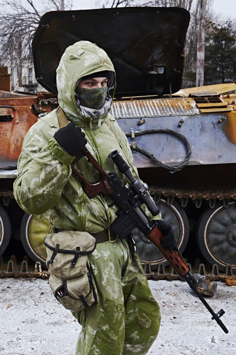 Pro-Russian separatist in Ukraine. Besides his SVD and Red Dawn style amoeba camo, also note the Slav sweetness of the SVD mag pouch!