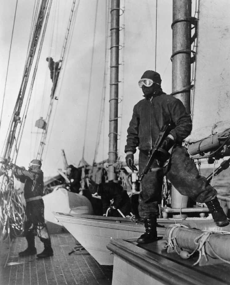 Coast Guard crew dressed to keep warm while on patrol aboard aboard a USCG schooner in 1943 while on coastal patrol in the U.S.