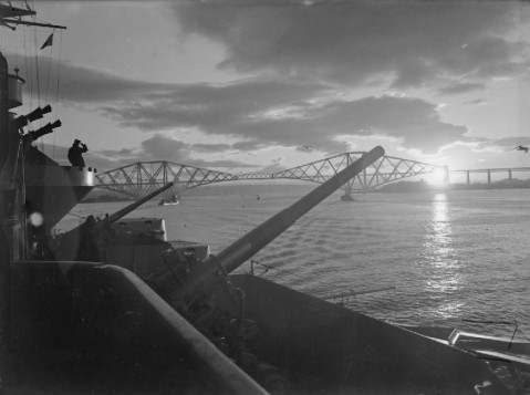 HMS Rodney on the Firth of Forth at sunset,