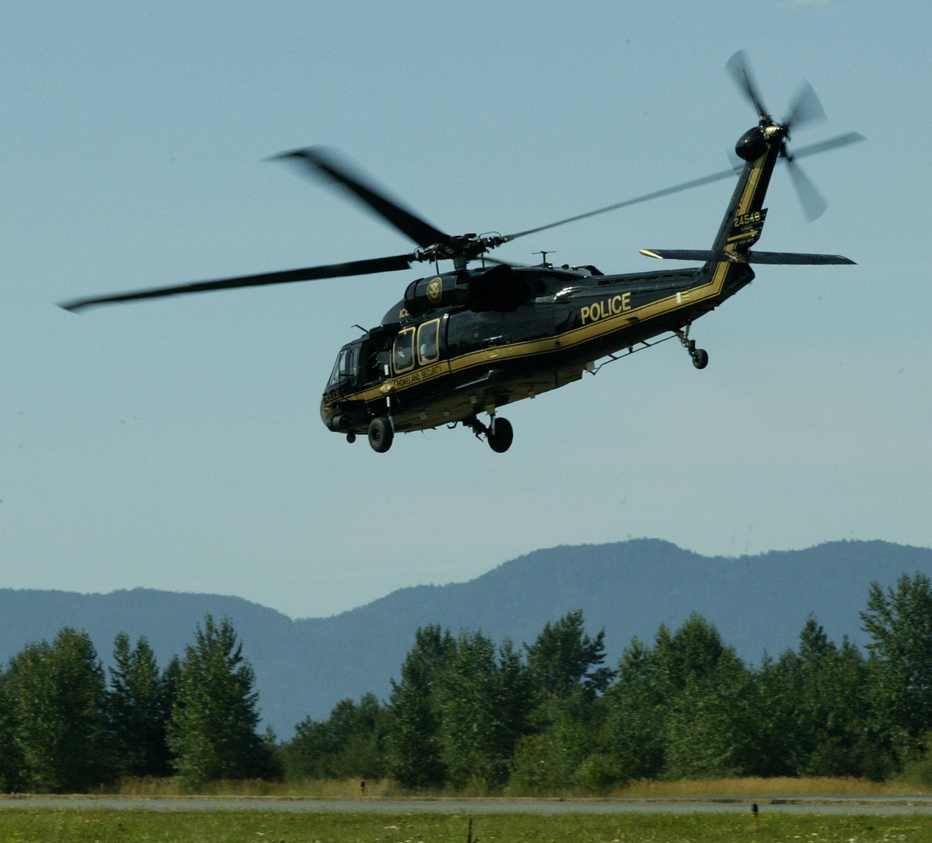 A UH-60-A Blackhawk helicopter used by the Immigration and Customs Enforcement Office of Air and Marine Operations takes off on a demonstration flight from the Bellingham International Airport Friday, Aug. 20, 2004 in Bellingham, Wash. Helicopters similar to this one will be based at the Department of Homeland Security Air and Marine facility based in Bellingham which began operations Friday along the U.S. - Canadian border. (AP Photo/Ted S. Warren)