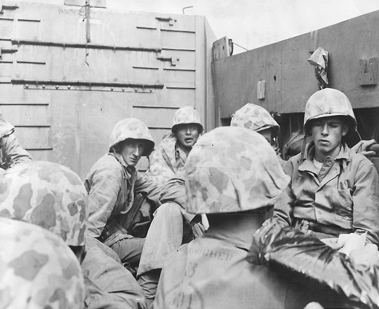 Marines crouched in a Coast Guard-manned LCVP on the way in on the first wave to hit the beach at Iwo Jima, 19 Feb 1945