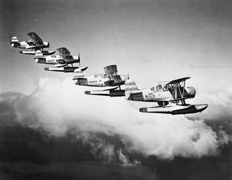 SOC-3 scout-observation floatplanes off cruiser Honolulu flying in formation, circa 1938-1939, note the prewar scheme. United States Navy Naval History and Heritage Command photo NH 82466