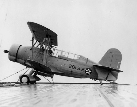 SOC-3A Seagull floatplane of US Navy Scouting Squadron 201 (VS-201) parked on the deck of escort carrier Long Island, 16 Dec 1941. Note the float has been replaced by landing gear