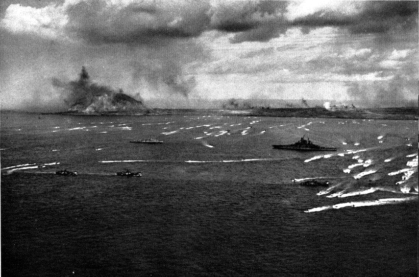 U.S. Navy/USCG invasion fleet off Iwo Jima, with LVTs and LCIs maneouvering near the battleship USS Tennessee (BB-43). 1945