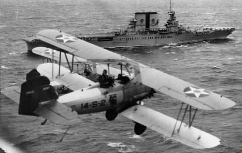 US Marine Corps Vought O2U-2 Corsair aircraft preparing to land on Saratoga, circa 1930 Source United States Navy Naval History and Heritage Command Identification Code NH 94899