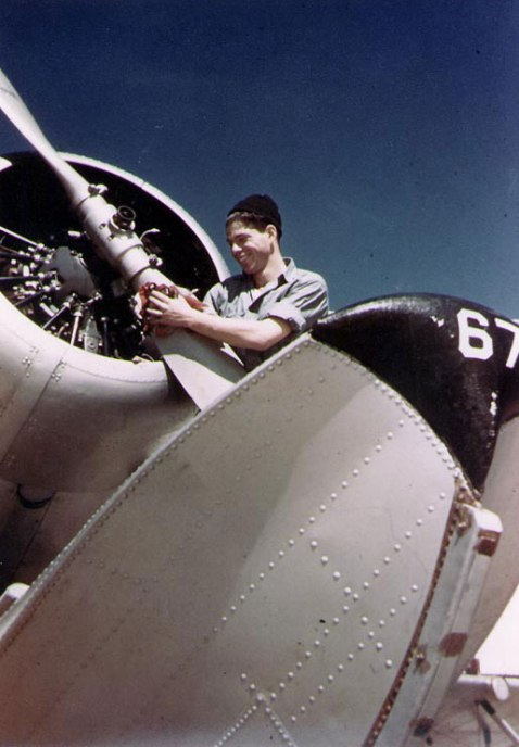 US Navy Aviation Machinist's Mate polishing the 9-foot propeller of a SOC Seagull floatplane at Naval Air Station, Pensacola, Florida, United States, circa 1940-41. Photographer Dayton A. Seiler, United States National Archives 80-G-K-13541