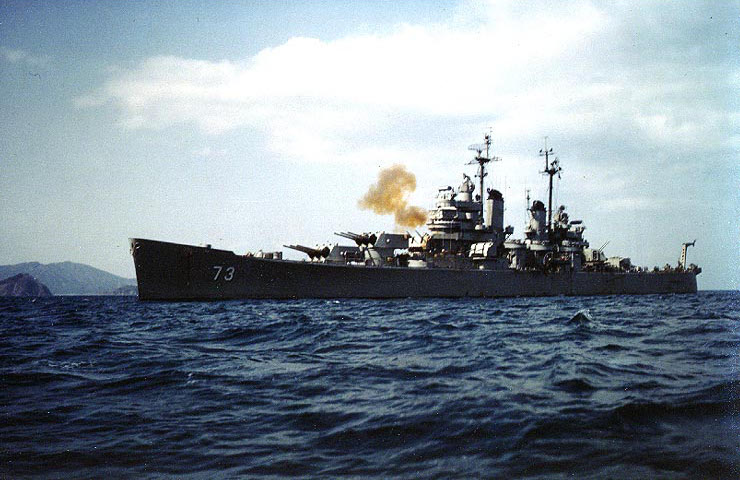 USS Saint Paul bombarding communist positions near Wonsan, Kangwon Province, Korea, 20 Apr 1951