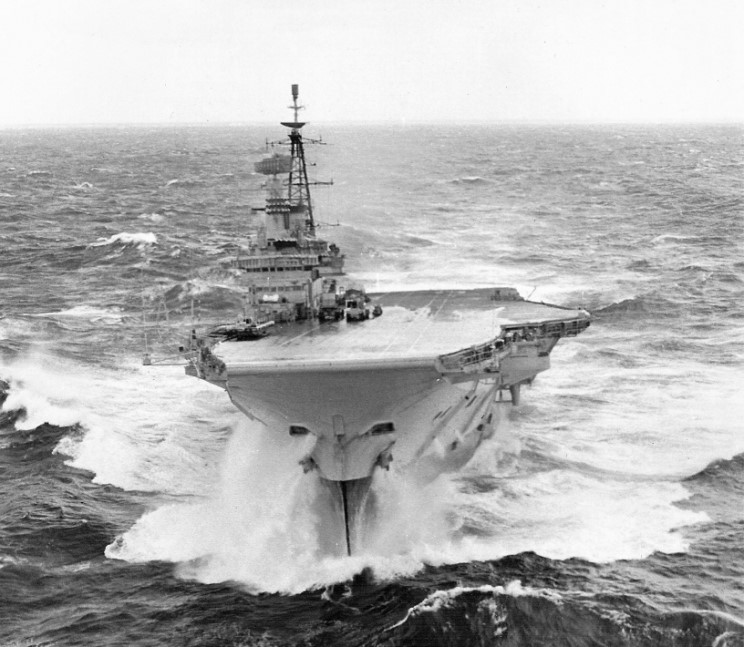 1977 HMS Hermes R-12 with her bows nearly out of the water.