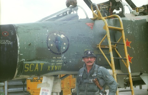 "United States Air Force Colonel Robin Olds stands in front of his F-4C Phantom II ""SCAT XXVII"". Olds named  all of his aircraft after his Westpoint roommate, Scat Davis, who couldn't become a military pilot due to poor eyesight. (USAF photos via the National Museum of the USAF)"