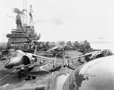 HMS HERMES' flight deck as she sails from Portsmouth for the South Atlantic. Five Sea Harriers of No 800 Squadron Fleet Air Arm