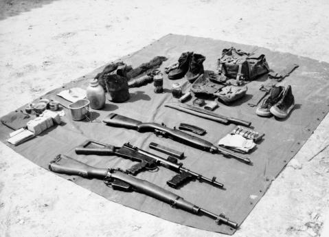 Lee Enfield Rifle No.5 Mk.I, Owen sub-machine gun and an M1 Carbine malaya 1950s