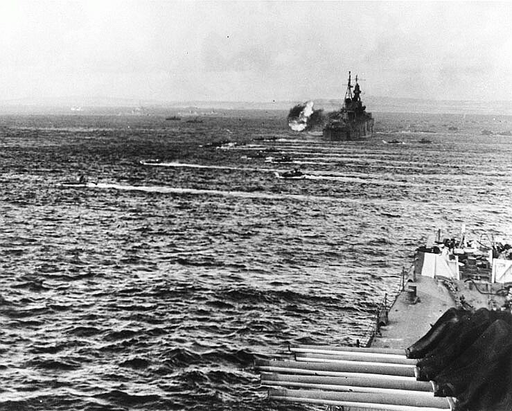 LVTs moving in during the invasion of Saipan, 15 June 1944. Heavy cruiser firing in the background is USS Indianapolis